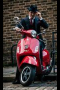 Photo 12 from album Driving a scooter in a suit